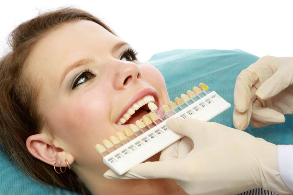 woman getting teeth whitened