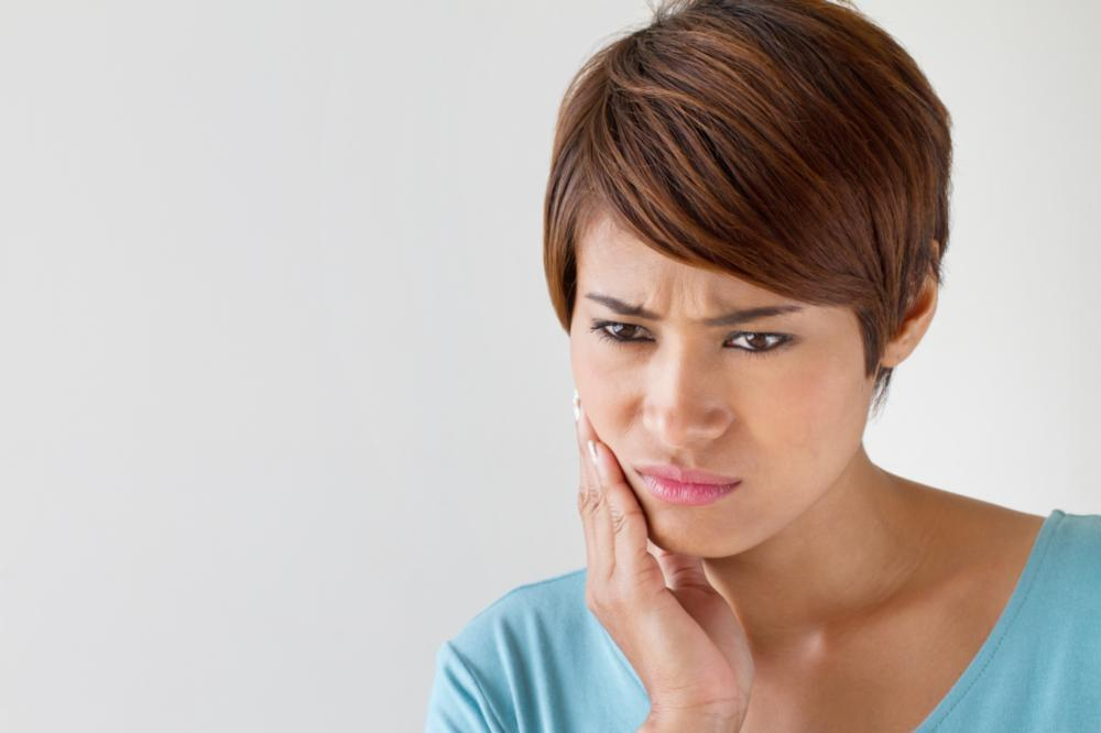 woman in need of root canal treatment in vienna va