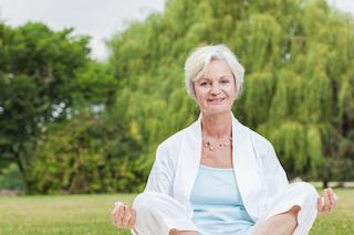 a woman relaxes in a park | Sedation Dentistry Vienna VA