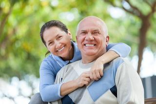 an old couple smiles | Tooth Extractions Vienna VA