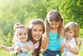 children smile in a meadow | Pediatric Dentistry