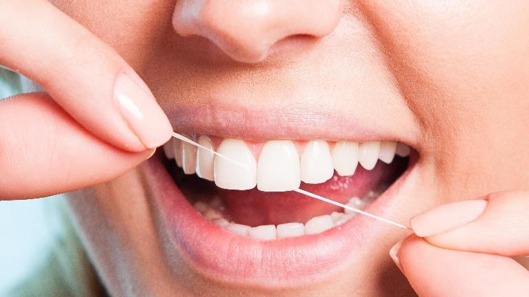 flossing tips | mouth with floss | Vienna VA