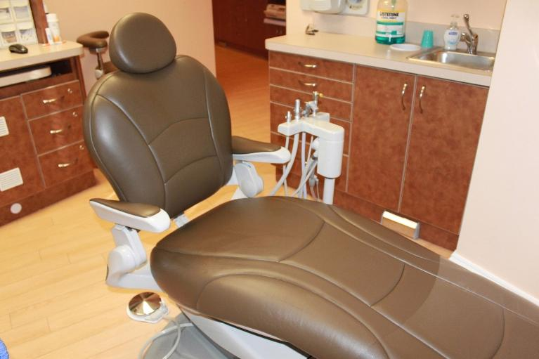 a brown dental chair in a dental operatory | dentist in vienna, va